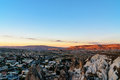 View of cave houses and rock formations at sunset. Goreme. Cappadocia. Turkey Royalty Free Stock Photo