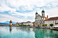 View at the Chapel bridge over Reuss river and Jesuit church in Luzern Royalty Free Stock Photo