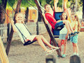 View on children swinging together on children's playground Royalty Free Stock Photo