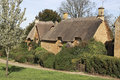 View of chipping campden cottage in spring a a road side thatch this quaint village is known for it s unspoilt limestone cottages Stock Image