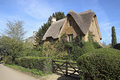 View of chipping campden cottage in spring a a road side thatch this quaint village is known for it s unspoilt limestone cottages Stock Photography