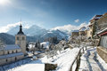 View of the church and the castle in the gruyere village on a sunny winter day switzerland Royalty Free Stock Photos