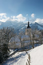 View of the church in gruyere village on a sunny winter day switzerland Stock Images
