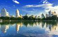 View of the city and lake garden in daytime blue sky reflection in Royalty Free Stock Photo