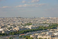 View of the city of paris from the eiffel tower a tourist s s second level on a warm summer day Royalty Free Stock Image