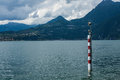 View on coast line of Lake Como, Italy, Lombardy region. Italian landscape view with mountains, lake and sky. Royalty Free Stock Photo