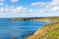 View from coast path kenneggy cornwall uk sand england west of praa sands and penzance on the south west with blue sky and sea on Royalty Free Stock Photo