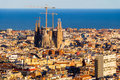 View of the construction sagrada familia and over the sea of houses in barcelona with approx million inhabitants barcelona is Stock Photos