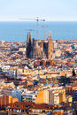 View of the construction sagrada familia and over the sea of houses in barcelona with approx million inhabitants barcelona is Stock Images