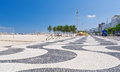 View of copacabana beach with palms and mosaic of sidewalk in rio de janeiro brazil Stock Image