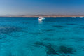 View at the coral sea and white yacht. Perfect place for snorkeling. Summer vacation at sea Royalty Free Stock Photo