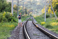 View of countryside Railroad and Hiker waiting the Train