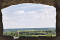 View on countryside through recess of fortress picturesque views wall clear summer day Royalty Free Stock Image