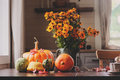 view of cozy autumn breakfast at country house with tea, bagel and seasonal decorations
