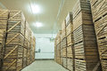 View on crates of potato in storage house rows Stock Photography