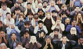 View of crowd covering ears Royalty Free Stock Photo