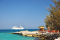 The view of cruise and hut at coco cay bahamas Royalty Free Stock Photos