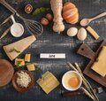 View of a delicious cheese platter with walnuts, eggs, and flour on the table with JUNE word Royalty Free Stock Photo