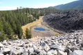 View of deschutes national forest with pond and obsidian flow rocks Stock Photos