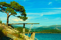 View of diving board springboard to dive at water summer vacation and dangerous sport fjord landscape Stock Images