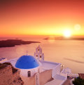 View of a dome of the church st spirou in firostefani on santor blue island santorini greece at sunset Royalty Free Stock Images