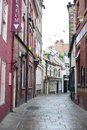 View down quaint cobbled grape lane whitby in north yorkshire with colourful bunting hung between the historical buildings and Stock Image