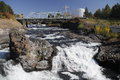 View of downtown spokane with falls bridge world s fair pavilion river crashes over rocks in river and in background blue sky Royalty Free Stock Photos