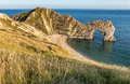 View of durdle door in united kingdom sometimes written dor is a natural limestone arch on the jurassic coast near lulworth dorset Royalty Free Stock Photos