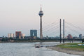 View of dusseldorf in germany with the television tower rheinturm at the river rhine after sunset Royalty Free Stock Photos