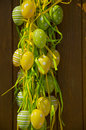 View of Easter decoration with green and yellow painted eggs Royalty Free Stock Photo