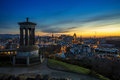 A view of Edinburgh and Dugald Stewart Monument at the sunset
