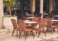 View of empty  terrace of open-air cafe with tables and chairs in old town of Budva. Montenegro. Royalty Free Stock Photo