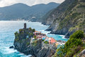View of famous travel landmark destination Vernazza, a small mediterranean old sea town with harbour coast and castle Royalty Free Stock Photo