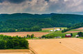 View of farm fields and distant mountains from a roadside overlo Royalty Free Stock Photo