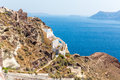 View of Fira town - Santorini island,Crete,Greece. White concrete staircases leading down to beautiful bay Stock Images