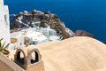 View of Fira town - Santorini island,Crete,Greece. White concrete staircases leading down to beautiful bay Royalty Free Stock Image