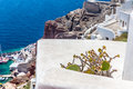 View of fira town santorini island crete greece white concrete staircases leading down to beautiful bay with clear blue sky and Royalty Free Stock Photo