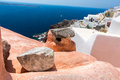 View of fira town santorini island crete greece white concrete staircases leading down to beautiful bay with clear blue sky and Royalty Free Stock Photos
