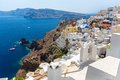 View of fira town santorini island crete greece white concrete staircases leading down to beautiful bay with clear blue sky and Royalty Free Stock Image
