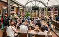 stock image of  View of the food court area full of people at the Queen Victoria Market in Melbourne Australia