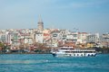 View of galata tower across the bosporus and ferry Stock Image