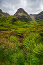 View of glen coe mountains with greenery foreground scotland great britain Stock Photography