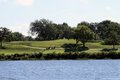View Of Golf Course Across A Lake Royalty Free Stock Photo