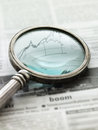 View of graph in newspaper through magnifying glass financial section a seen a Royalty Free Stock Image