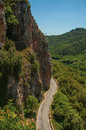 View of green valley and cliff, cut by road, near Châteaudouble. Royalty Free Stock Photo