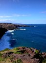 View of the hana highway from cliff tops on maui cliffs and ocean a Royalty Free Stock Photos