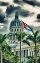 View of Havana Capitol building dome with cuban flag