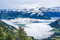 View from high top with fog ocean below and alp mountain in the