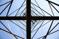 View at a high-voltage electricity pylon from directly below, wh Royalty Free Stock Photo