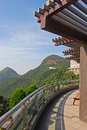 View of hills from balcony with pergola on top floor building Stock Photo